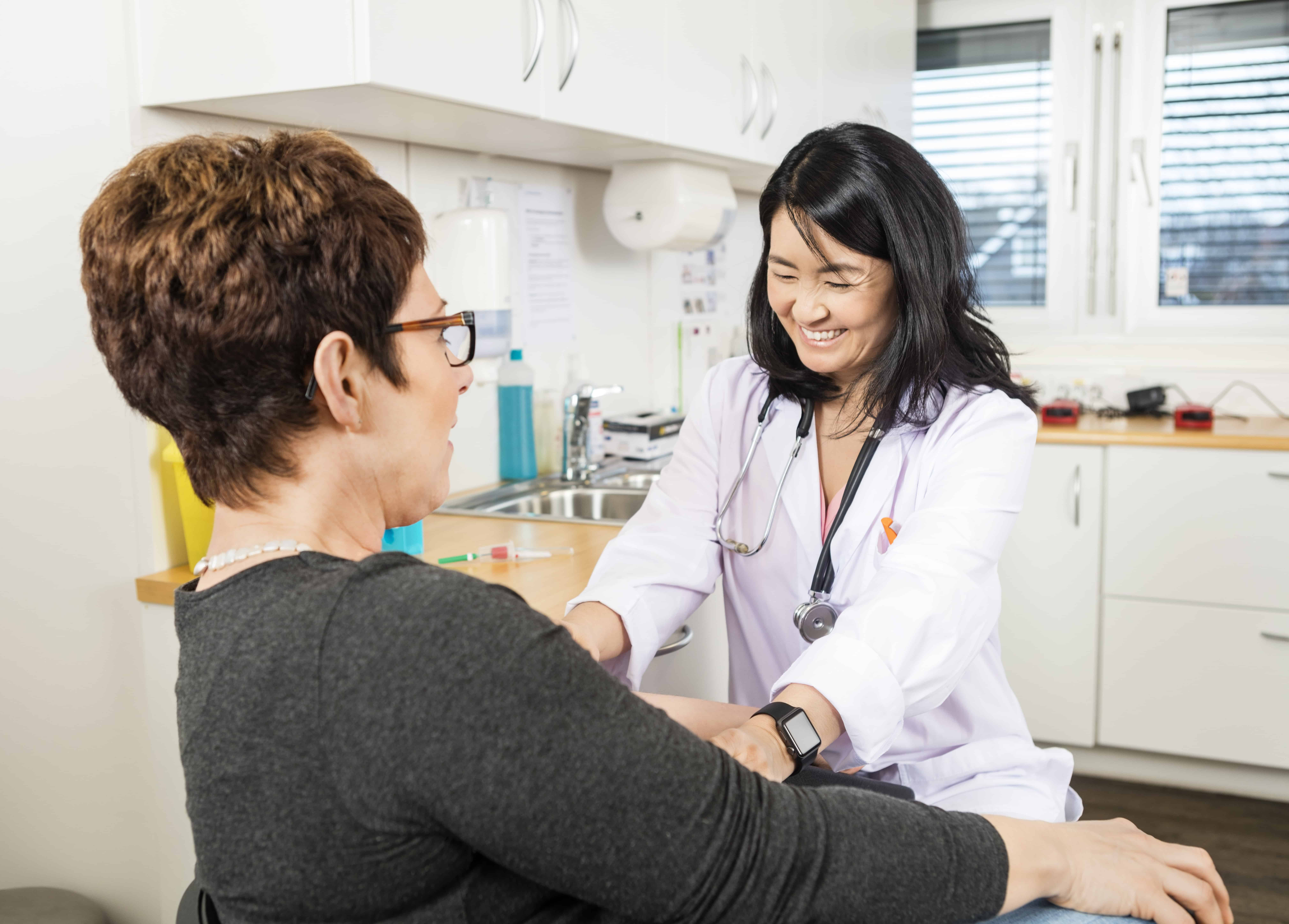 Phlebotomist Smiling Near Patient